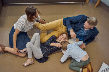 Happy family relaxing on the floor at home - BEF00147