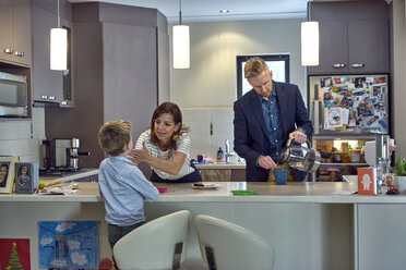 Everyday Scene of a family in kitchen at home - BEF00150