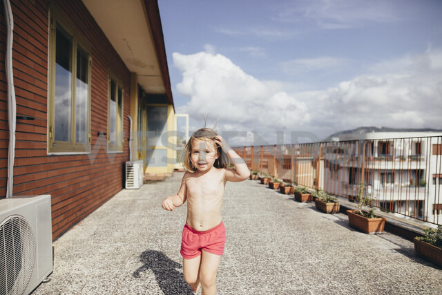 Italy, Naples, portrait of little girl on roof terrace - KMKF00248
