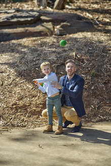 Father and son playing with foam baseball bat and ball - BEF00155