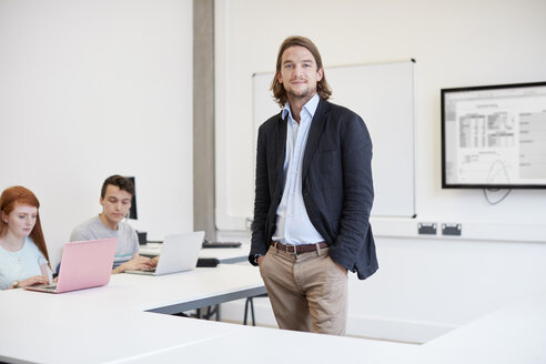 Portrait of male lecturer in higher education college classroom - CUF22185
