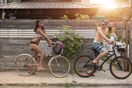 Young couple on bicycles, Rockaway Beach, New York State, USA - ISF08038