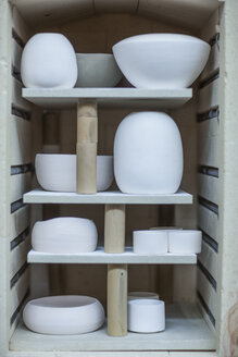 Finished pottery vases and bowls in workshop kiln - ISF08119