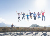 Group of people jumping in air, young boy sitting on wall, Sequoia National Park, California, USA - ISF08588
