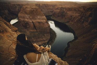 Women relaxing and enjoying view, Horseshoe Bend, Page, Arizona, USA - ISF08765