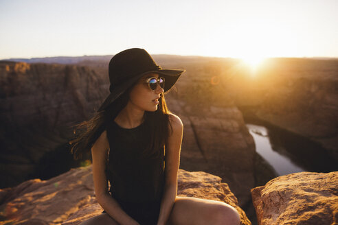 Woman relaxing and enjoying view, Horseshoe Bend, Page, Arizona, USA - ISF08777