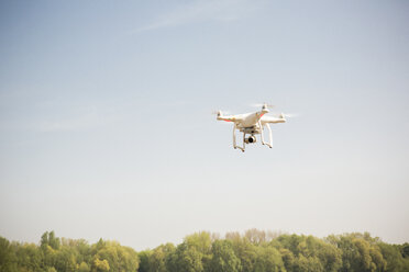 Drone flying in blue sky - ONF01141