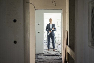 Architect standing in building under construction - MOEF01277
