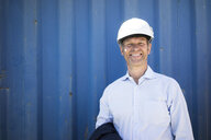 Portrait of smiling man wearing shirt and hard hat - MOEF01301