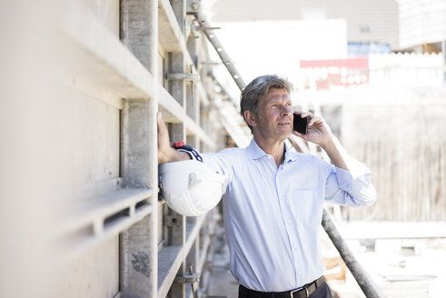 Man on cell phone on construction site - MOEF01310