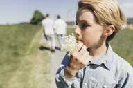 Boy with blossom in his mouth - KMKF00337