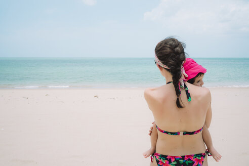 Thailand, Koh Lanta, back view of woman and little daughter on the beach - GEMF02050
