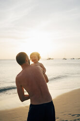 Thailand, Koh Lanta, father playing with his little daughter on the beach - GEMF02056