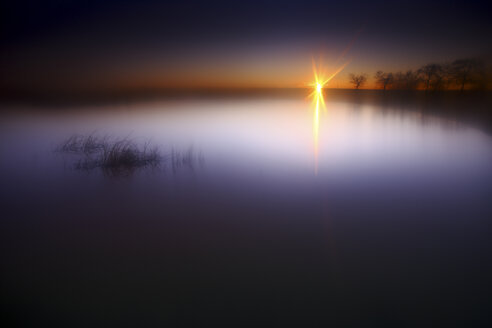 Spain, Castilla y Leon, Province of Zamora, Reserva natural de Lagunas de Villafafila, lake at sunset - DSGF01743