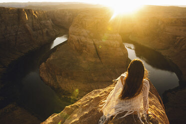 Woman relaxing and enjoying view, Horseshoe Bend, Page, Arizona, USA - ISF08852