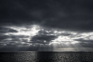 Sunbeams through clouds over sea, Guadalupe Island, Mexico - ISF08858