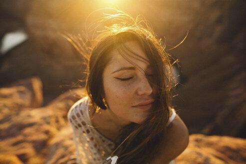 Woman enjoying breeze, Horseshoe Bend, Page, Arizona, USA - ISF08957