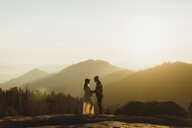 Pregnant couple in mountains, Sequoia national park, California, USA - ISF09008