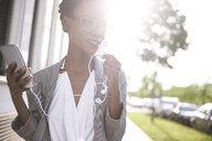 Portrait of smiling businesswoman on the phone - ABIF00550