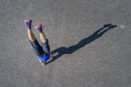 Aerial view of sportive young woman training handstand - STSF01602
