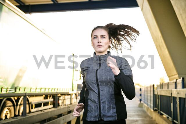 Portrait of sportive woman jogging - MMIF00129
