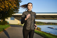 Portrait of sportive woman jogging - MMIF00132