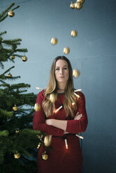 Portrait of annoyed woman at Christmas time - MOEF01360