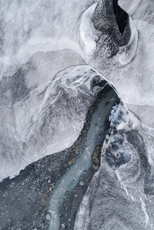 Drone view of stream flowing through glacier, Kverkfjöll, Iceland - FSIF03135