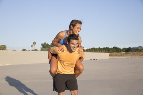 Athletes playing piggyback, Van Nuys, California, USA - ISF09291