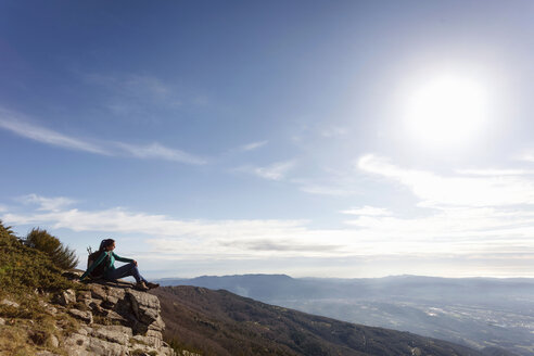 Hiker enjoying view from hilltop, Montseny, Barcelona, Catalonia, Spain - CUF23295