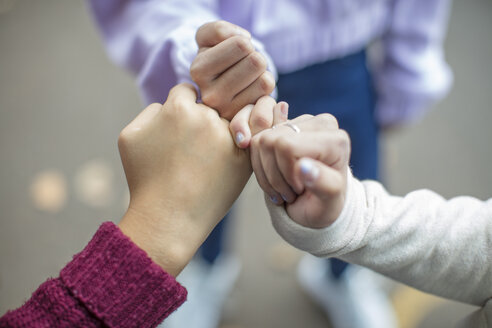 Close-up of teenage girls making a pinky promise - ZEF15602