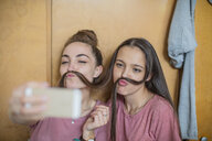 Playful happy teenage girls taking a selfie - ZEF15638