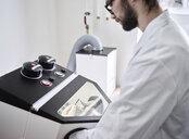 Chemical laboratory technician working in laboratory - CVF00721