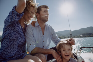 Happy family on a sailing boat - JLOF00027