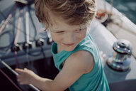 Smiling boy on a sailing boat - JLOF00042