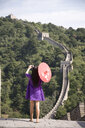 Rear view of mid adult female tourist photographing on the Great Wall of China, Beijing, China - CUF23641