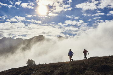 Two men trail running, Valais, Switzerland - CUF23887
