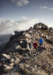 Trail runners on rocky path, Valais, Switzerland - CUF23899