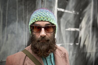 Portrait of bearded mature man with beanie and sunglasses - CUF24136