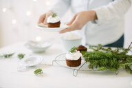 Chocolate cupcakes topped with whipped cream - CUF24196