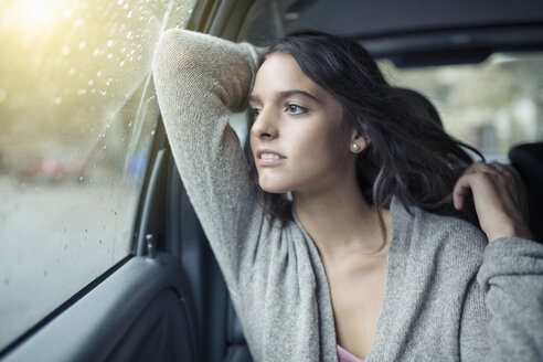 Woman looking out of car window - CUF24199
