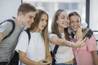 Happy students taking a selfie in school - ZEF15706