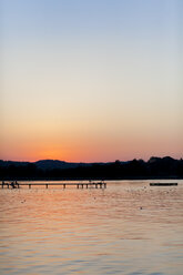 Germany, Bavaria, Chiemsee, boardwalk at sunset - MMAF00377