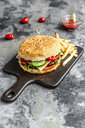 Homemade Hamburger with cheese, french fries, ketchup and tomato - SARF03765