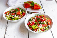 Two bowls of salad with watermelon, cucumber, feta and mint - SARF03768
