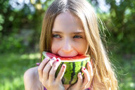 Portrait of girl eating watermelon in summer - SARF03771