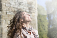 Portrait of carefree woman at Thornbury Castle, South Gloucestershire, UK - CUF24706