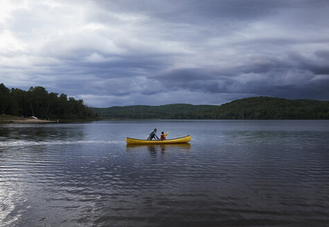 Father and son canoeing on lake, Arrowhead Provincial Park, Ontario, Canada - ISF09371