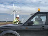 Windfarm engineers with truck on windfarm - CUF25520