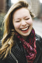 Portrait of woman eyes closed laughing - ISF09461